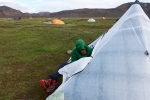 Jon is sorting stuff out in the tent trying to hide from the gusts