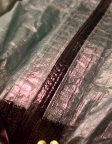 Waterproof #3 YKK zipper. Sewn and taped.